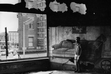 Arthur Tress, Boy in Burnt-out Furniture Store (1969)